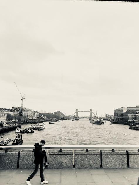 A Man, on his Phone, & London Bridge