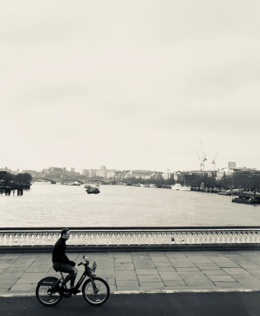 A Man on his Bike, on a Bridge